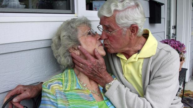 Bruce and Esther Huffman kiss during an interview in McMinnville, Ore. Photo: Rick Bowmer