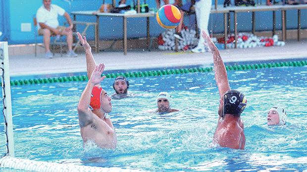Aleksandar Ivocic of San Giljan lobbing the ball over Neptunes goalkeeper. Photo: Wally Galea
