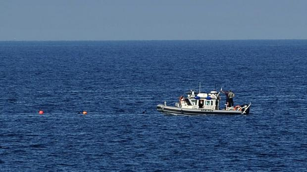 AFM rescuers search for the Mr Zammit's body. Photo: Chris Sant Fournier