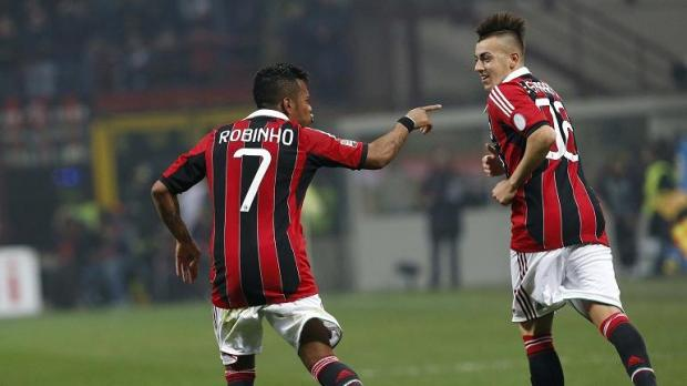 AC Milan's Robinho (L) celebrates with his team mate Stephan El Shaarawy.