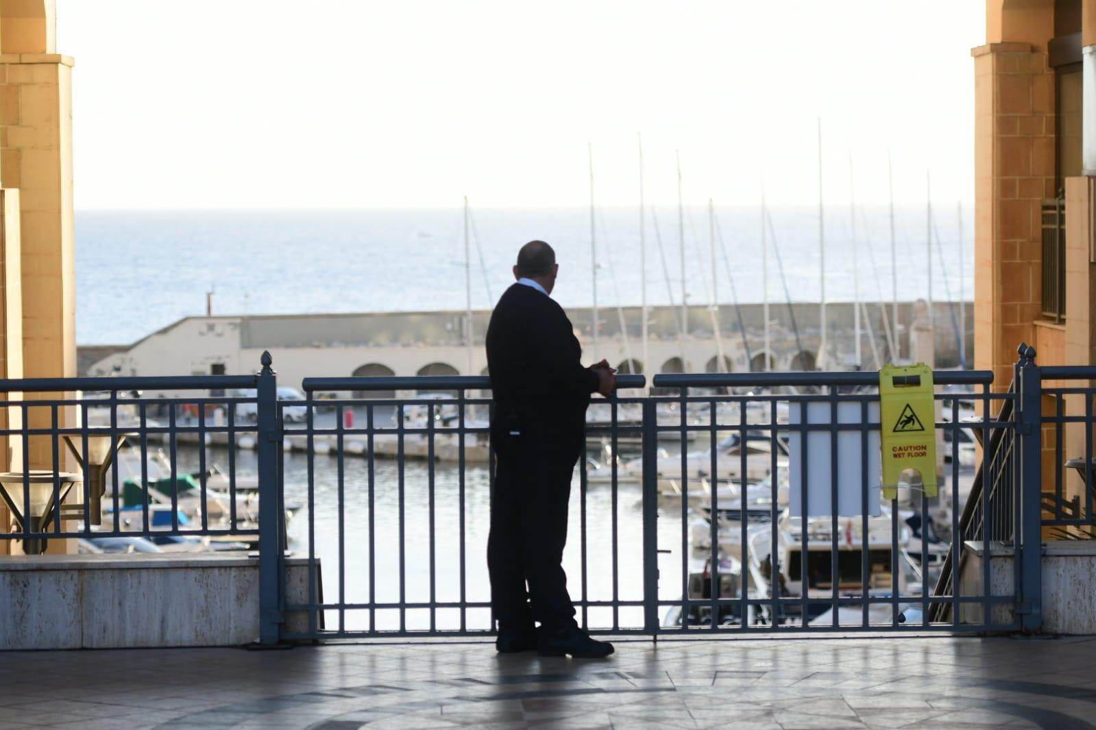 A police officer stands guard outside Portomaso on Wednesday morning. Photo: Jonathan Borg