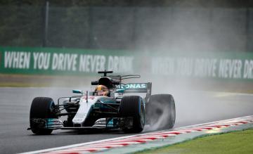 Lewis Hamilton steers his Mercedes around the Suzuka track.