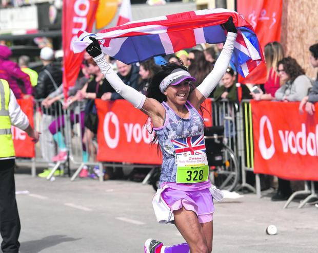 A British runner celebrates after reaching the finish line in the 2018 Malta Marathon. Photo: Mark Zammit Cordina