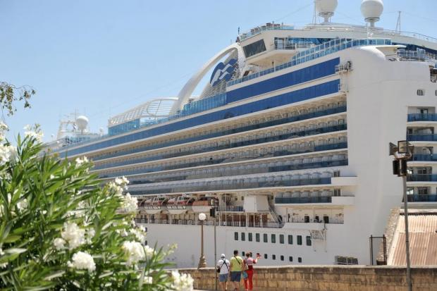 The cruise liner Emerald Princess dominates the background in the Grand Harbour in Valletta on July 1. Photo: Chris Sant Fournier