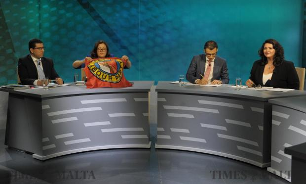 Marlene Farrugia brings out a labour party flag before the start of the first television debate at PBS studios on May 15. Photo: Matthew Mirabelli
