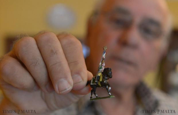 Enthusiast Joe Galea Debono displays one of the 5000 hand painted figures, which make up the diorama of the battle of Waterloo. Mr Galea Debono has painstakingly painted each soldier during the weekends over a period of 12 years. Photo: Matthew Mirabelli