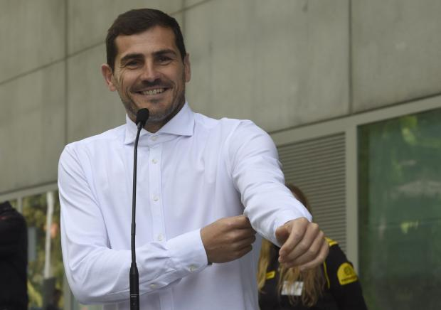 Porto's Spanish goalkeeper Iker Casillas smiles as he addresses journalists after leaving a hospital in Porto.