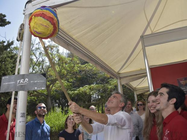 Opposition Leader Simon Busuttil takes his chance at hitting a float filled with sweets during Freshers' Week at the University of Malta in Tal- Qroqq on October 4. Photo: Mark Zammit Cordina