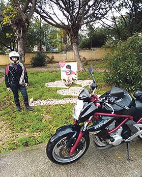 Josephine Boni stands near the shrine commemorating her daughter, Johanna, who was crushed to death by a cement mixer in Naxxar three years ago while riding her motorcycle (foreground) to work.