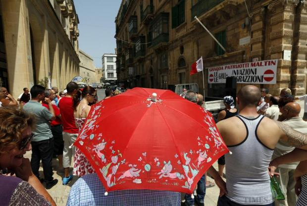 Supporters of Għaqda Patrijotti Maltinattend a corner meeting in Valletta on June 14. The group said it has collected over 10,000 signatures petitioning the government not to impose the integration of migrants. Photo: Darrin Zammit Lupi