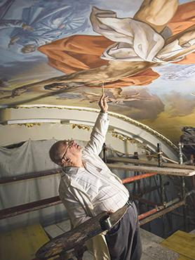 Paul Camilleri Cauchi putting the finishing touches on the figure of St Andrew. Photo: Lorella Castillo