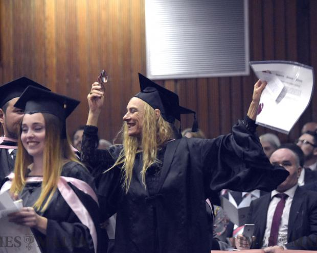 A student celebrates moments after receiving her diploma at a graduation ceremony at the University of Malta on November 13. Photo: Mark Zammit Cordina