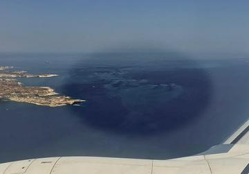The massive spread of sludge believed to be from fish farms is seen clearly in this aerial shot above the south of Malta. Photo: Daniel Cilia