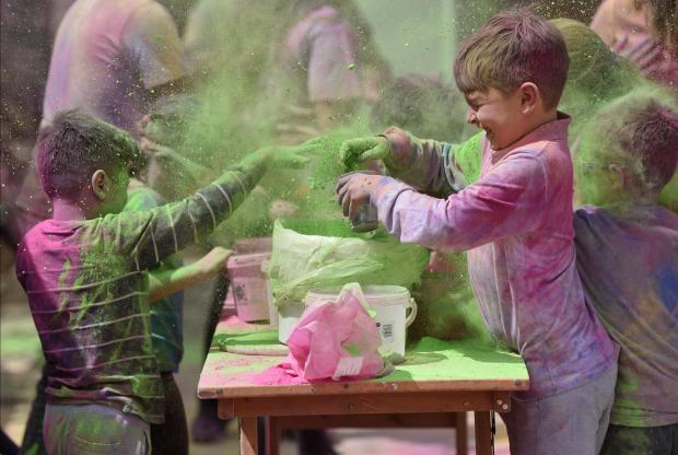 Two boys throw coloured powder paint on themselves during the Cordina Holi Festival organized by the Indian Community held in St Venera on April 06. Photo: Mark Zammit Cordina
