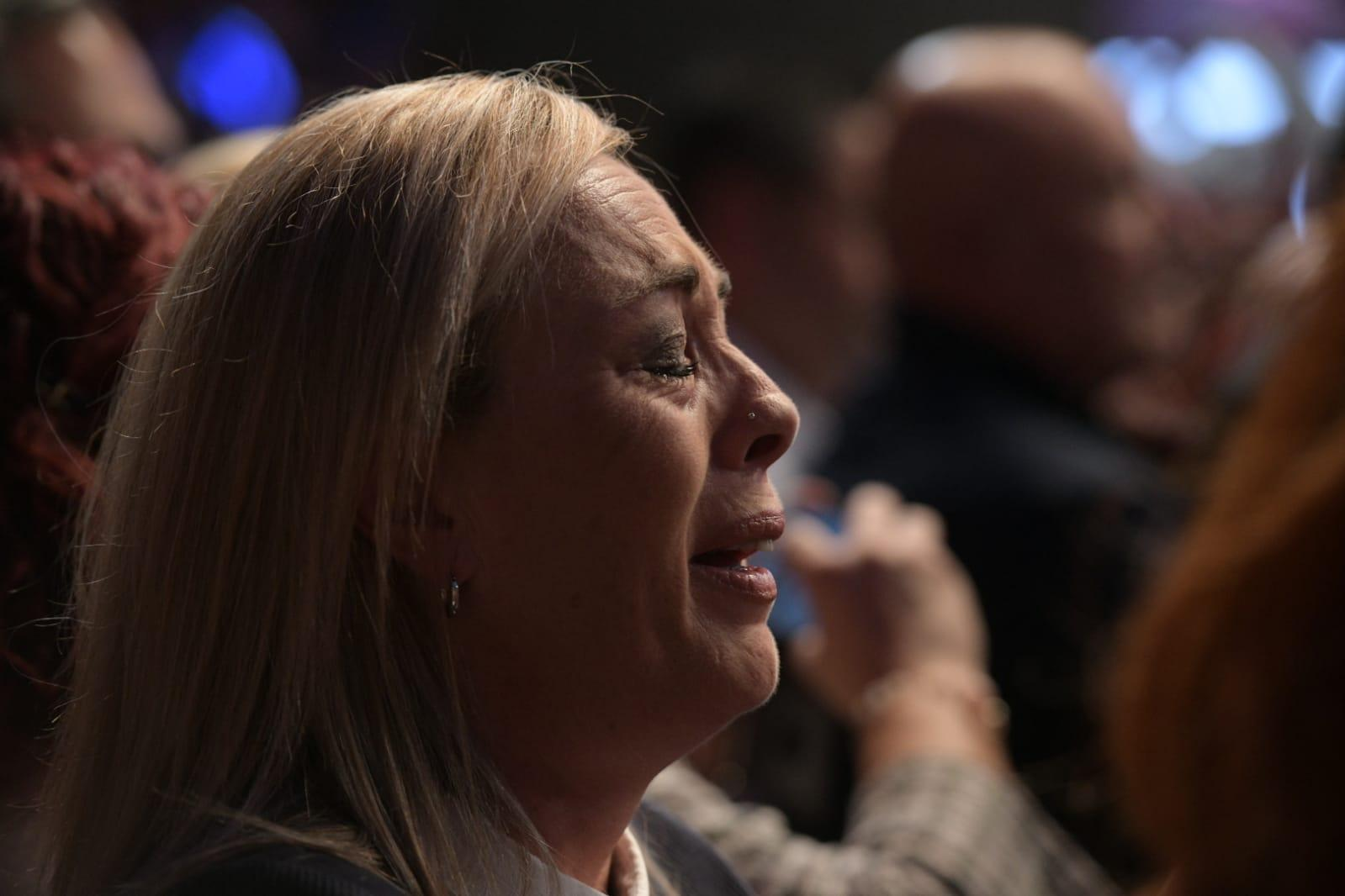 A woman in the crowd weeps as Joseph Muscat delivers his final speech. Photo: Matthew Mirabelli