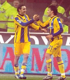 Happy times... Andrea Pisanu (left) during his successful spell with Parma.