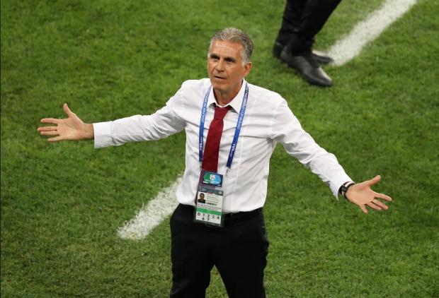 An unhappy looking Iran coach Carlos Queiroz. Photo: Reuters