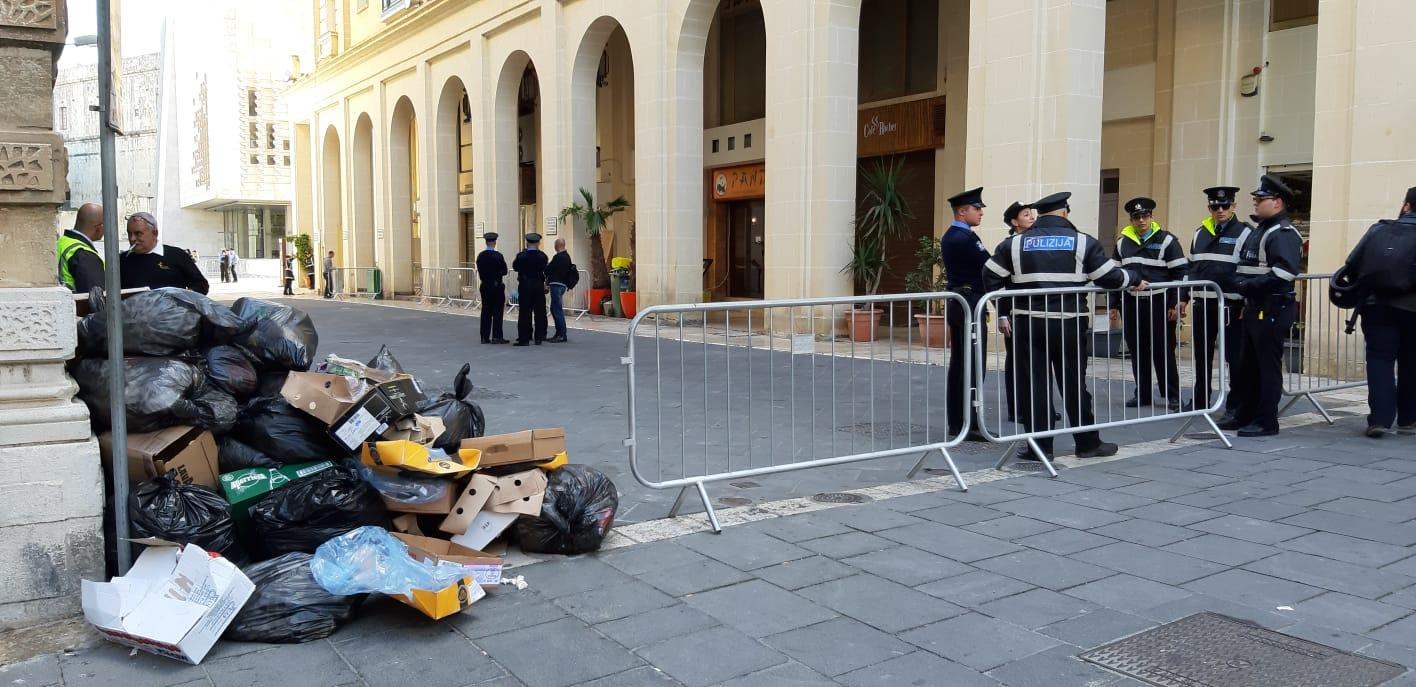 Police, barricades and a mound of uncollected rubbish along Ordnance Street. Photo: Chris Sant Fournier
