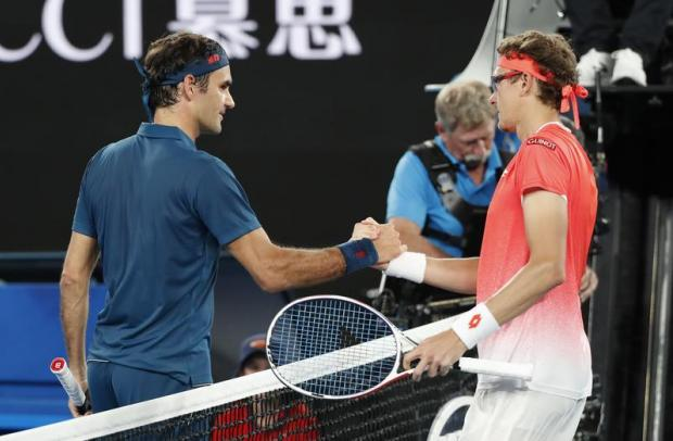 Switzerland's Roger Federer and Uzbekistan's Denis Istomin greet each other after the match.