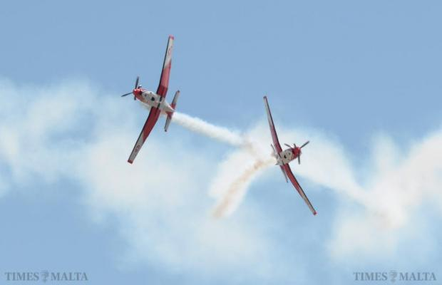 Two Swiss Air Force PC-7s break away from each other during their routine during the Malta International Airshow on September 27. Photo: Matthew Mirabelli