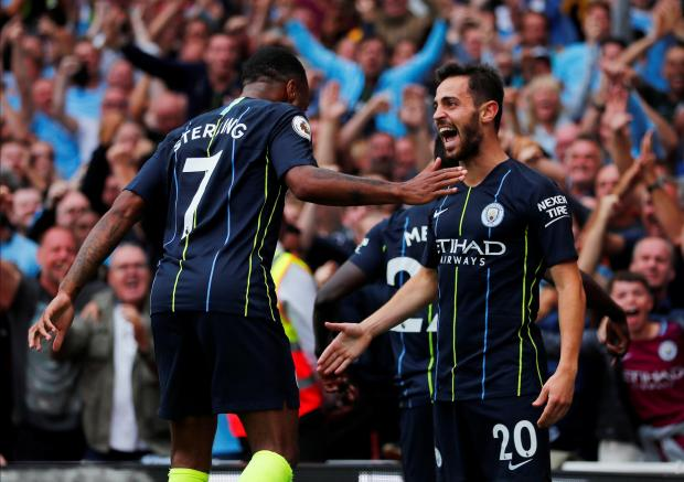 Manchester City's Bernardo Silva celebrates scoring their second goal with Raheem Sterling.