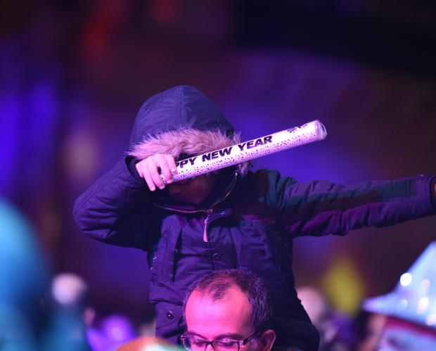 A boy holds a Happy New Year foam light in St Gorges Square Valletta during the New Years Eve Celebrations on 31 December. Photo: Mark Zammit Cordina