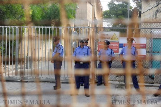 Policemen stand guard by the MIDI gate on Manoel Island as people gather for an attempted clean up of the area on September 17. Photo: Steve Zammit Lupi