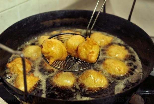 Zeppoli fritters sizzle away in oil at the Feast of St Joseph in Rabat on March 19. Photo: Chris Sant Fournier