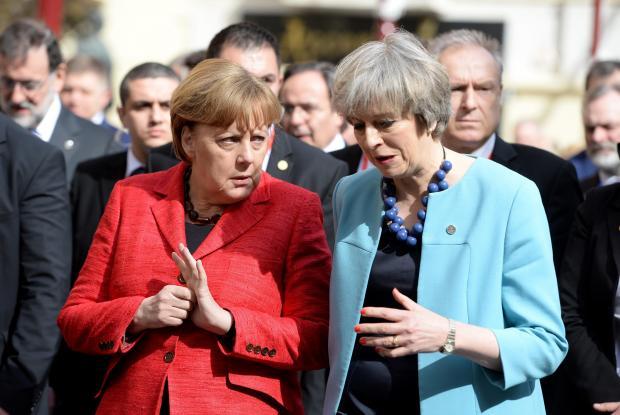 Angela Merkel and Theresa May walking down Republic Street. Photo: Matthew Mirabelli