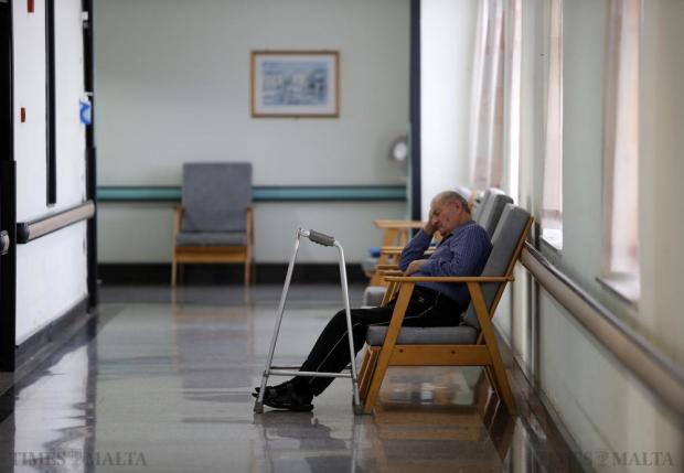 A resident at the Mtarfa Home for the elderly rests in a corridor on September 30. Photo: Darrin Zammit Lupi