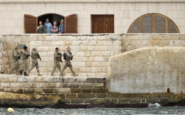Armed Forces of Malta soldiers patrol outside St Angelo Mansions during the Commonwealth Heads of Government Meeting (CHOGM) in Vittoriosa on November 28. Photo: Darrin Zammit Lupi
