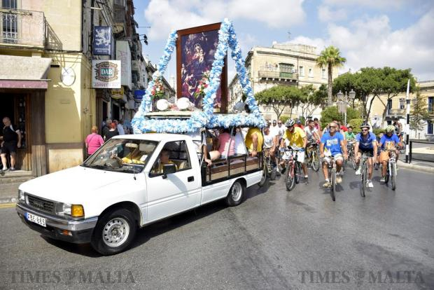 Pilgrims on bikes follow a pick-up truck carrying a large image of Our Lady of Graces, protector of cyclists, during the annual bike pilgrimage on September 11 as they pass through Hamrun. Photo: Mark Zammit Cordina