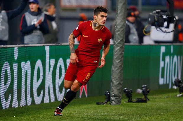 Roma's Diego Perotti celebrates scoring their first goal.