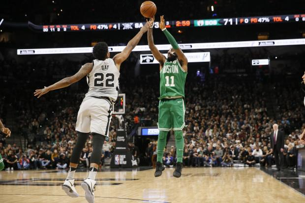 Boston Celtics point guard Kyrie Irving (11) shoots the ball over San Antonio Spurs forward Rudy Gay (22) during the second half at AT&T Center. Photo: Soobum Im-USA TODAY Sports