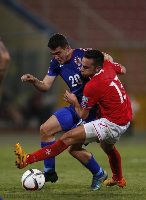 Croatia's Mateo Kovacic (left) and Malta's Andre Schembri (right) fight for the ball during their Euro 2016 Group H qualification soccer match at the National Stadium in Ta' Qali on October 13. Photo: Darrin Zammit Lupi