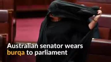 Watch: Australian senator wears burqa to parliament in bid to ban them