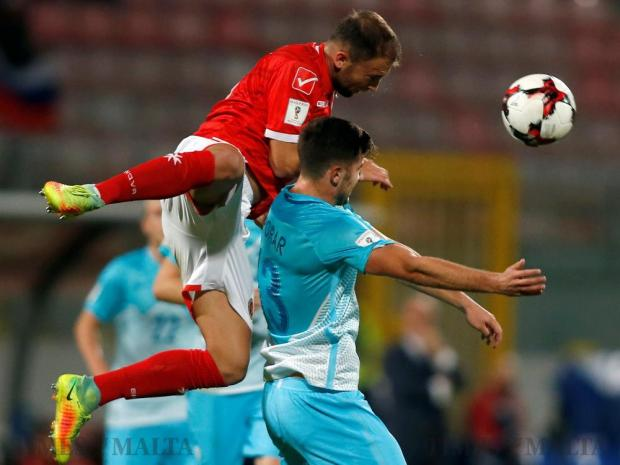 Malta's Andrei Agius fights for the ball with Slovenia's Andraz Sporar during their 2018 World Cup qualifying match at the National Stadium in Ta'Qali on November 11. Photo: Darrin Zammit Lupi