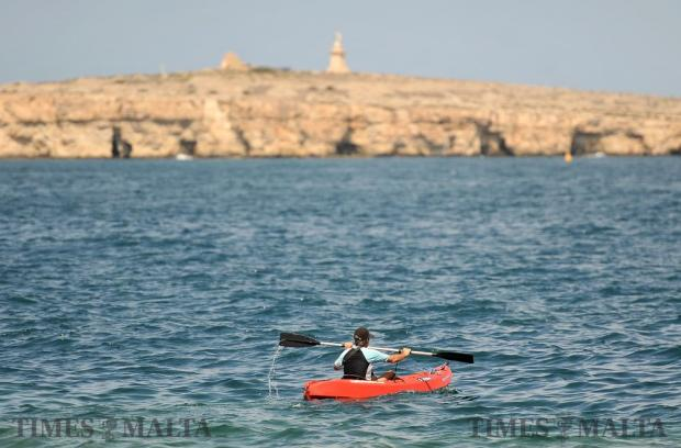 A man rows his canoe in St Paul's Bay on August 24. Photo: Chris Sant Fournier