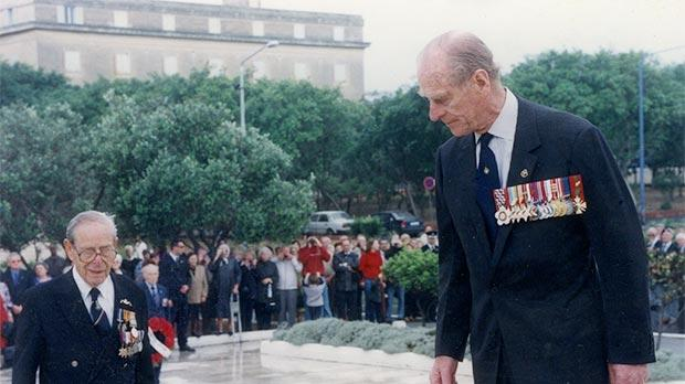 Prince Philip laying a wreath at the War Memorial in Floriana with Buhagiar on April 29, 2002.
