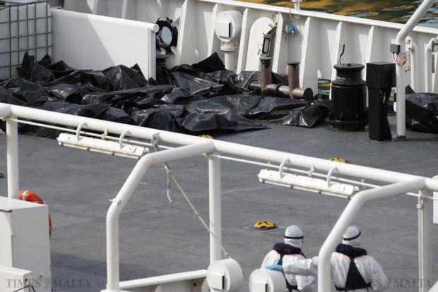 "Bodies of dead immigrants lie on the deck of the Italian coastguard ship ""Bruno Gregoretti"" in Senglea, on April 20. As many as 800 migrants were feared dead on Sunday after their boat capsized in the Mediterranean, raising pressure on Europe to face down anti-immigrant bias and find money for support as turmoil in Libya and the Middle East worsens the crisis. Photo: Darrin Zammit Lupi"