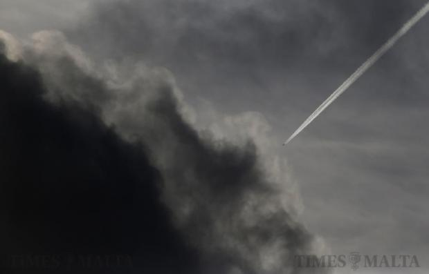 A Turkish Airlines Boeing 737 passenger plane flying from Istanbul to Accra leaves contrails as it passes over Malta on February 27. Photo: Darrin Zammit Lupi