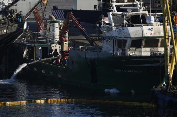 Water is pumped out of the 'Angela Arcella', a fishing trawler that had capsized in Grand Harbour after being struck by a larger cargo ship, after it was brought back to the surface at Laboratory Wharf on August 29. Photo: Darrin Zammit Lupi