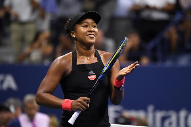 Naomi Osaka celebrates her victory over Madison Keys.