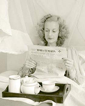 Cabaret performer and WWII glamour girl Christina Ratcliffe reading Times of Malta.