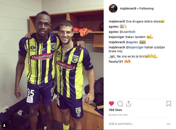Andrija Majdevac (right) poses with Usain Bolt in the locker room.