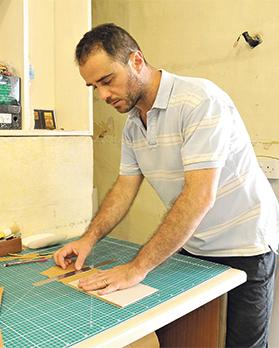 The book as art:Author and bookbinder Glen Calleja at work. Photo: Chris Sant Fournier