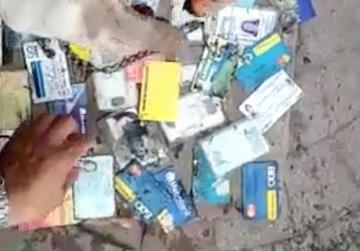 Dozens of wallets found in clogged-up drain