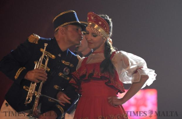 A Russian band member blows a kiss to a colleague during the Malta Military Tattoo held in Ta Qali on October 14. Photo: Mark Zammit Cordina