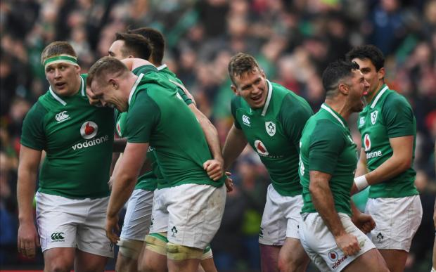 Ireland's Jacob Stockdale celebrates with team mates after scoring their fifth try.