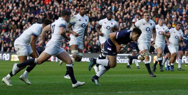 Scotland's Huw Jones runs in to score their first try.